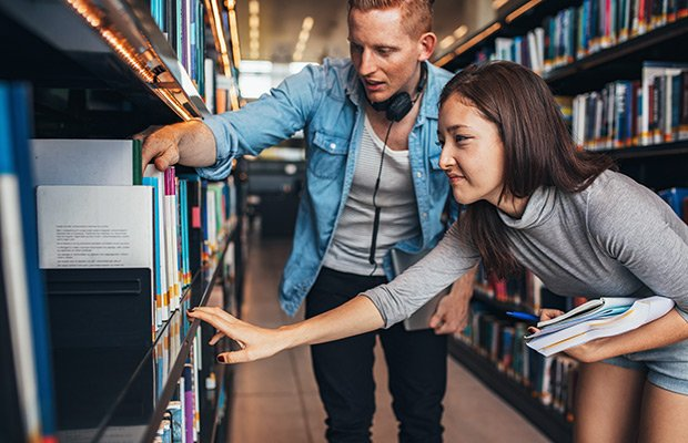 Students looking through library books