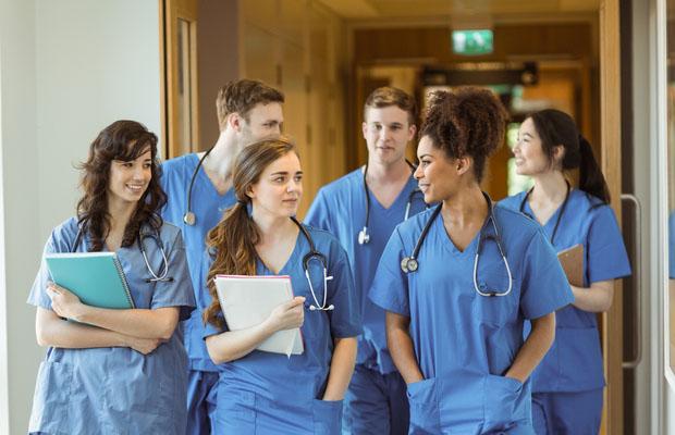 medical students walking down a corridoor