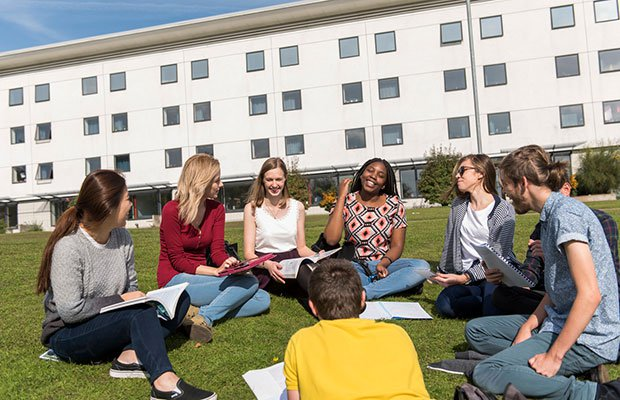 students chatting outside halls