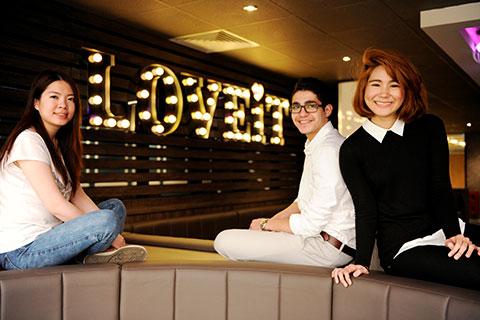Three students sit in Teesside Univesity's Students' Union LOVE IT lounge