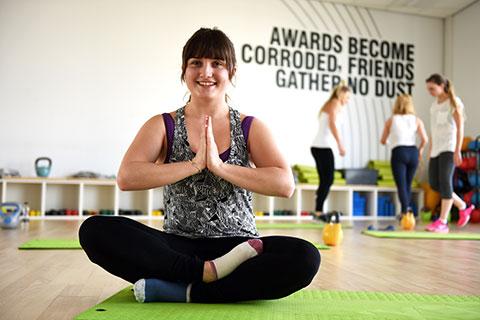 A Teesside University student enjoys her yoga class