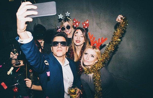 party goers taking selfie
