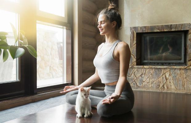 Relaxed female student meditating