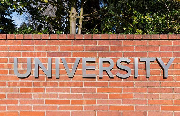 University sign on brick wall