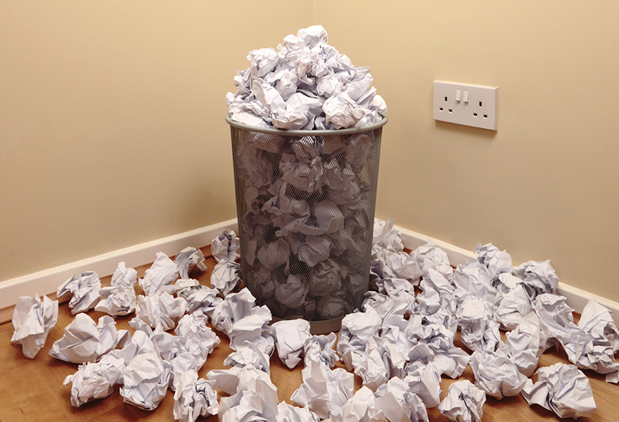 bin overflowing with waste paper