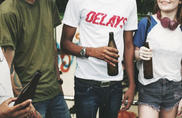 friends with bottles of beer
