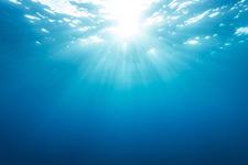 sun shining through water