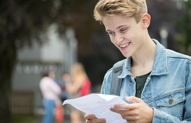 happy student with results