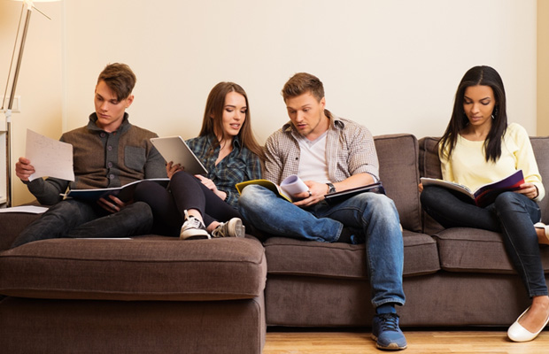 students sitting on a sofa