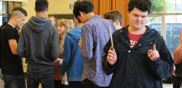 students reading results and celebrating
