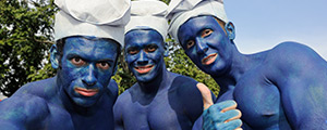three guys dressed up as smurfs