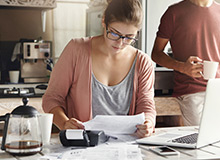 woman working out finances