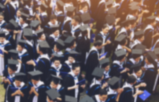 crowd of university graduates at ceremony