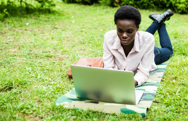 Student revising outside