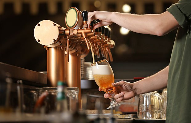 man pouring a beer