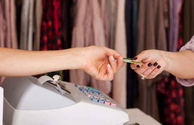 debit card being passed to shop assistant