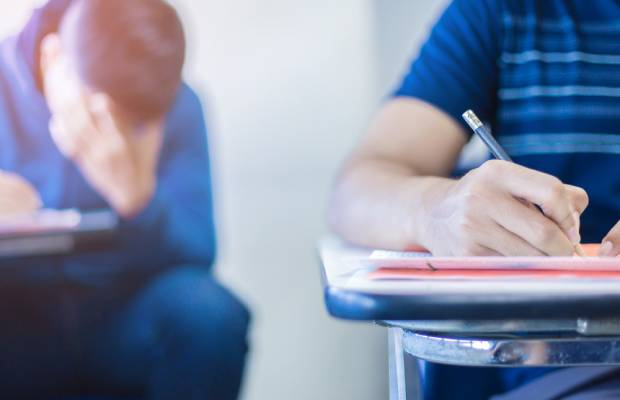 Students sit in exam