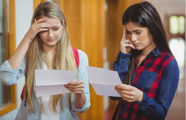 Concerned students looking at A-level results