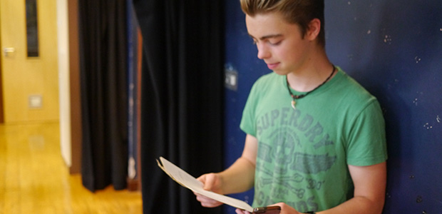student reading his results