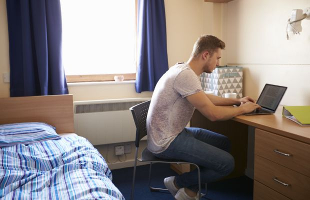 student working in halls room