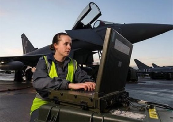 RAF personnel looking at computer in front of plane