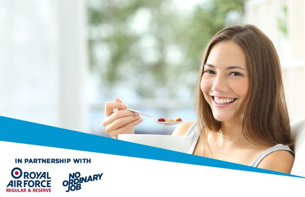 Woman eating breakfast and smiling