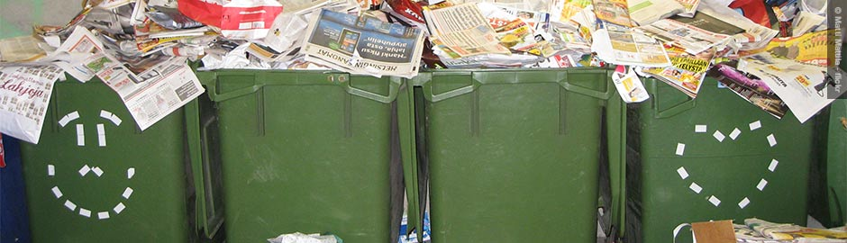 Overflowing recycling bins