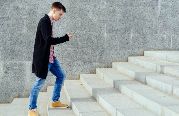 student walking up steps