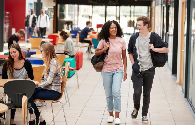 friends walking through university canteen