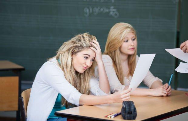 girl looking stressed in classroom