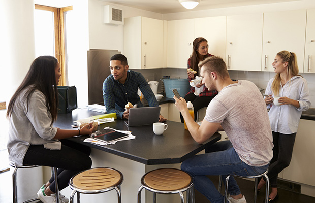Students in a shared kitchen