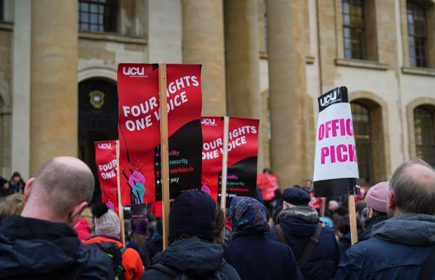 group of people holding UCU picket signs