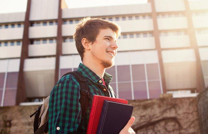 university student carrying books