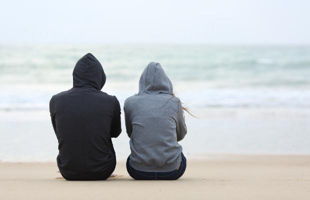 teens sitting on beach