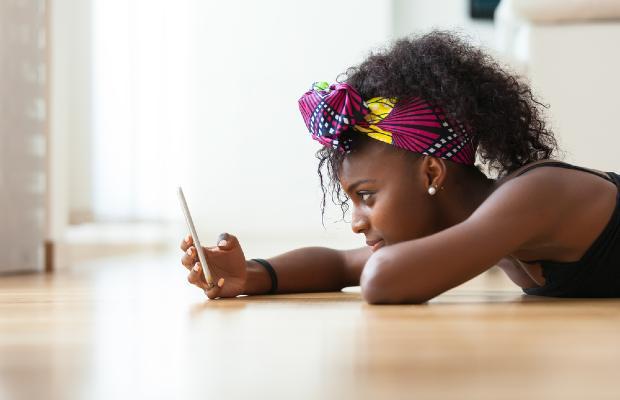 teenager staring at mobile phone