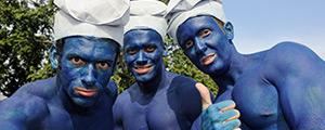 three guys dressed up as smurfs