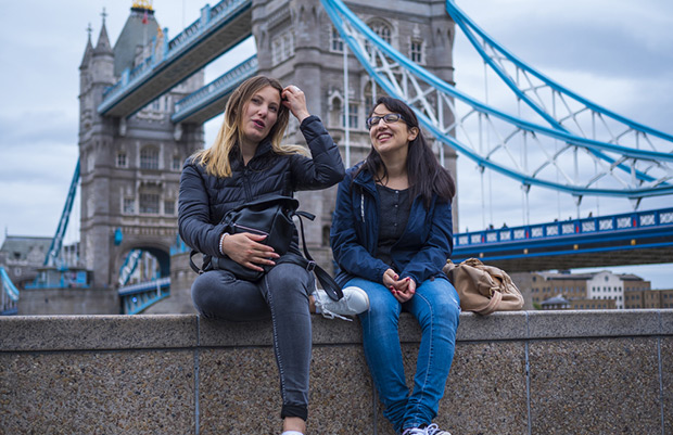 Students sitting by Tower Bridge
