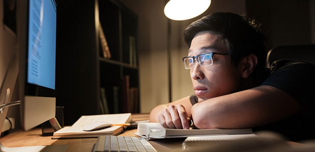 tired student looking at screen