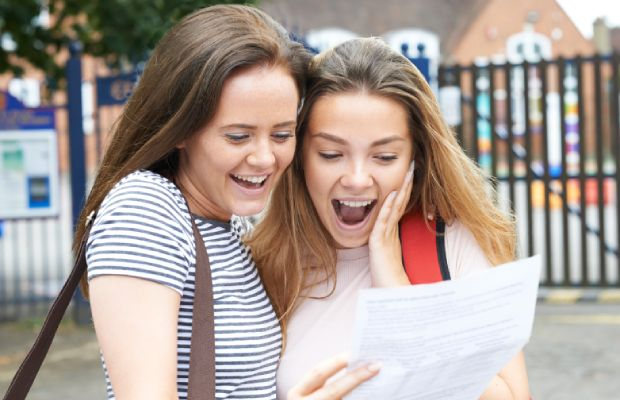 Two young women celebrate their results