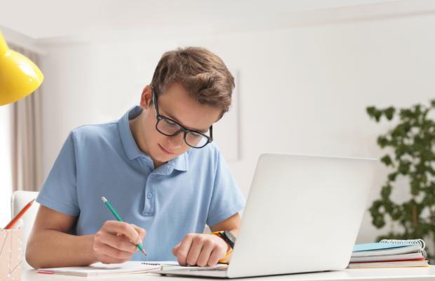 boy studying at laptop
