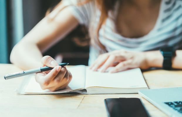 student doing homework at desk