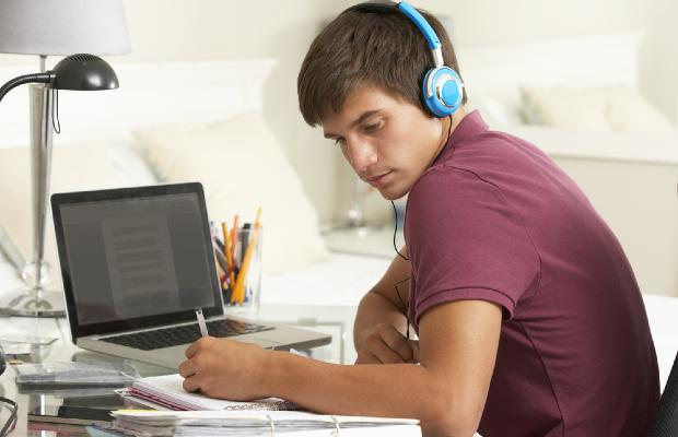 student working at laptop at home