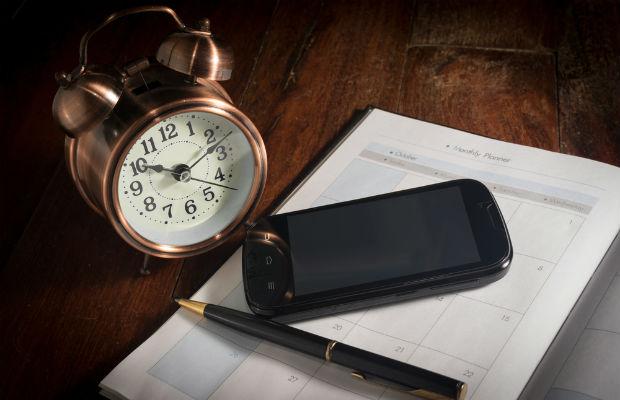 Alarm clock phone and notebook
