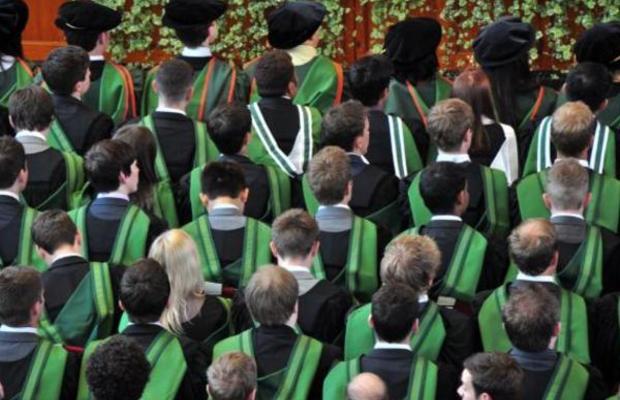 group of uni students graduating