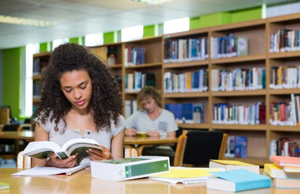 student working in library