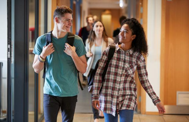 students walking through campus together