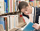 student in library
