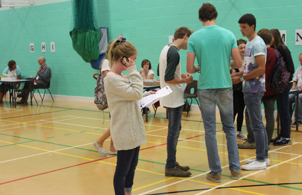student in hall collecting exam results