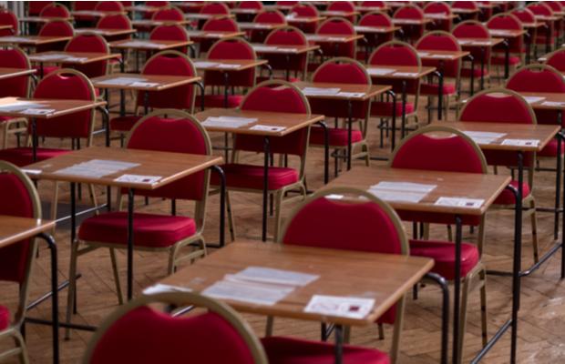 Empty desks in exam hall