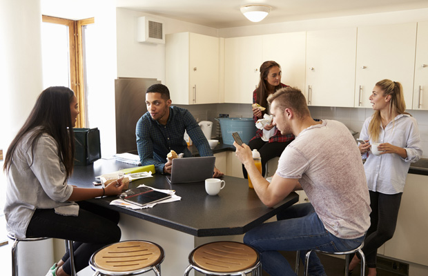 students talking in a kitchen